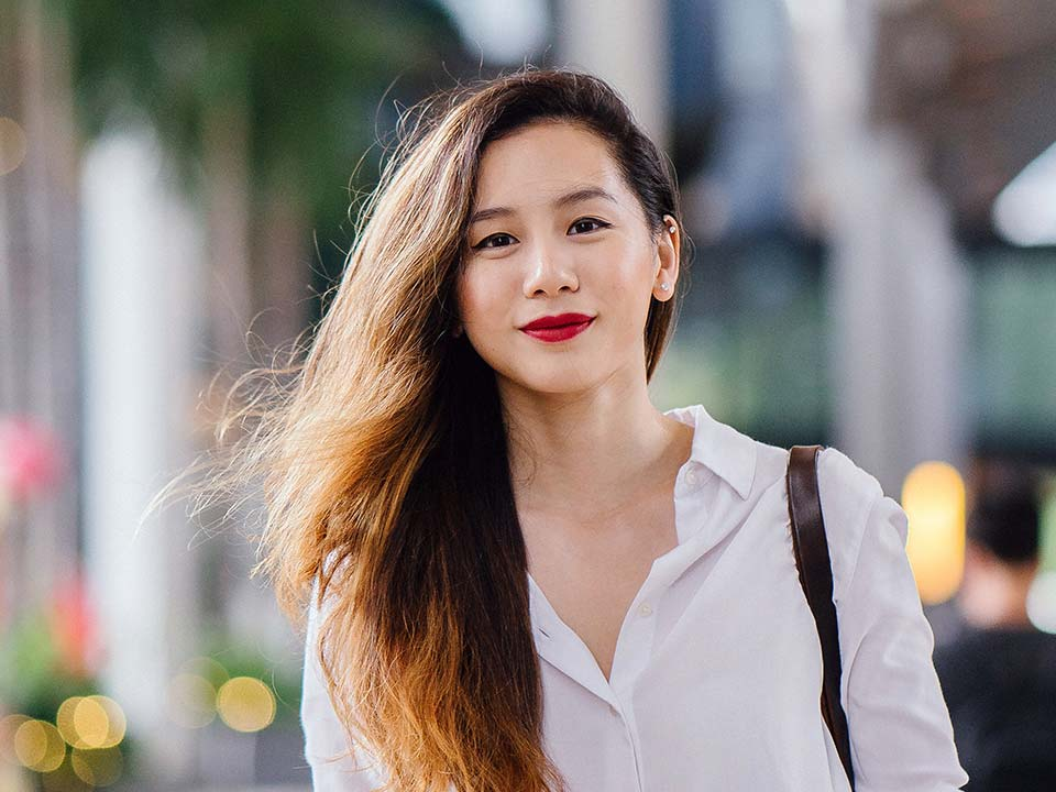 Asian girl smiling in the city