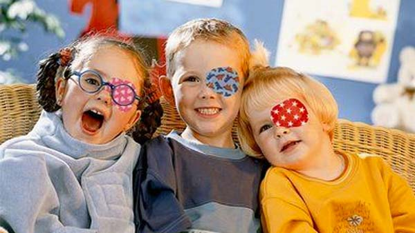 three children wearing eye patches to help fix amblyopia