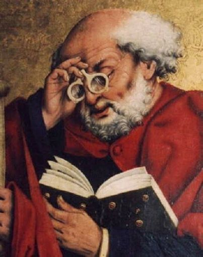 Friar Alessandro della Spina using early-form spectacles to read a book.
