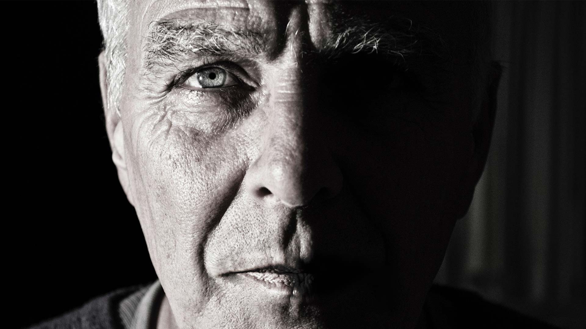 man's face focused on his eye