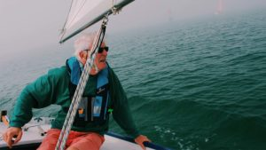Elderly man sailing