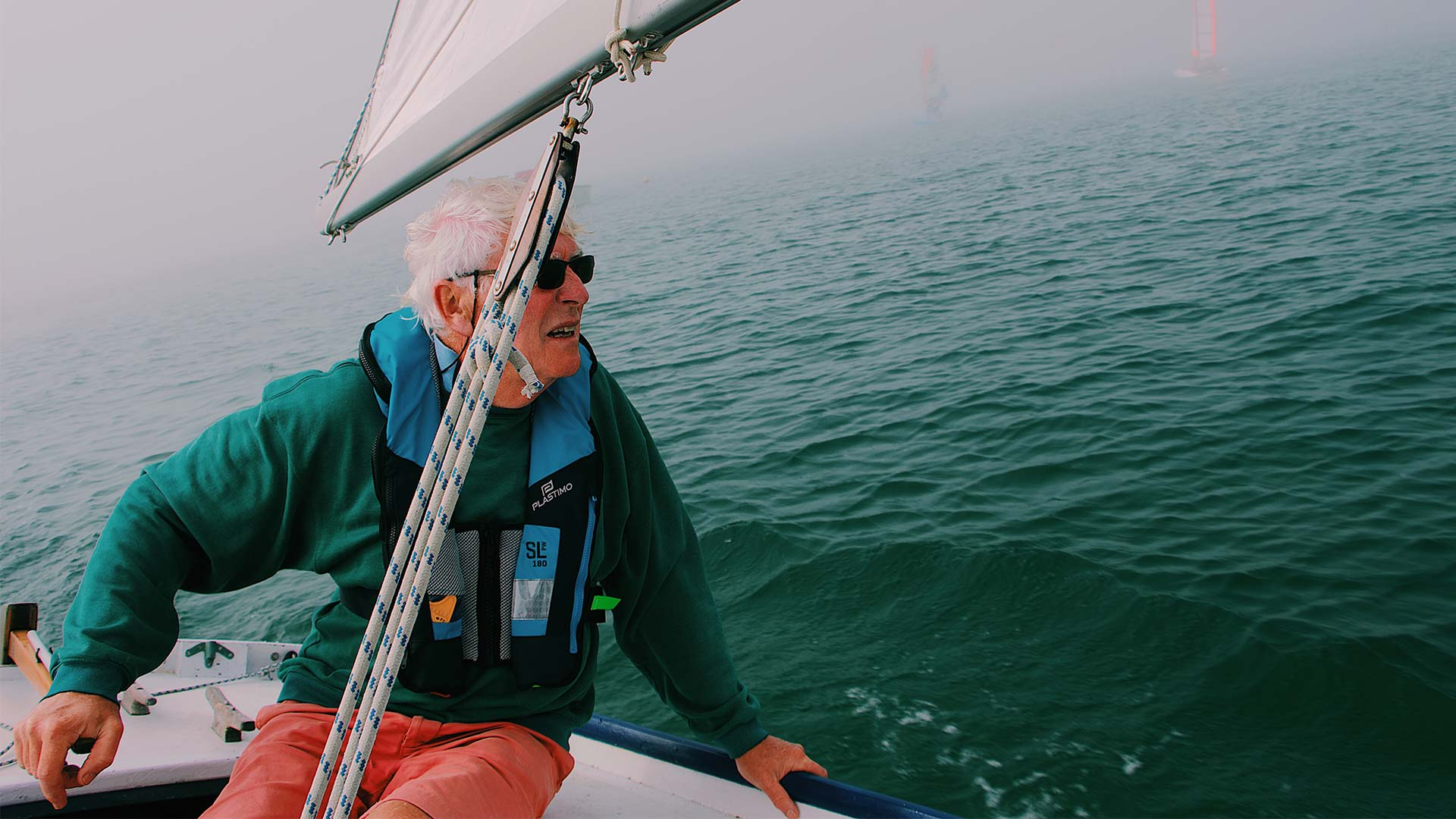 Elderly man sailing